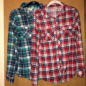 Two long sleeve button up flannel shirts